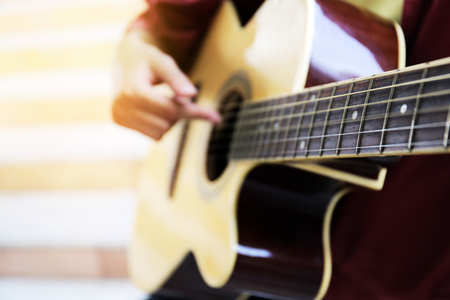 Close up beautiful woman playing acoustic guitar. Reklamní fotografie