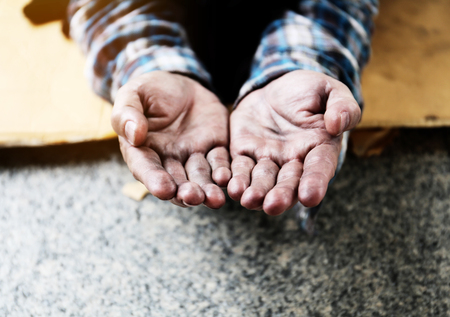 Close up hand of homeless man on walking street in the capital city. Stock Photo