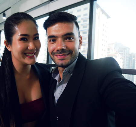 Close-up Business woman and business man selfie photo and break time for relaxation in office. Imagens