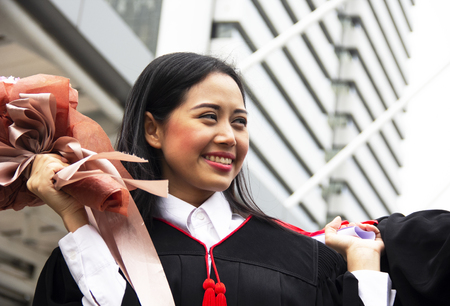 Beautiful Asia girl students are happy after graduation.