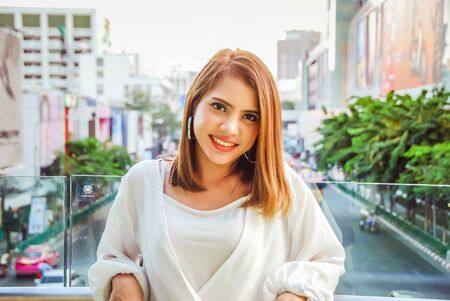 Close-up beautiful woman smile portrait and looking down on floor. Stok Fotoğraf - 126951329