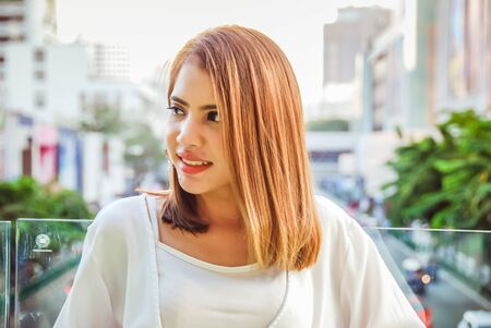 Beautiful woman smile portrait and traveling in the city Stock Photo