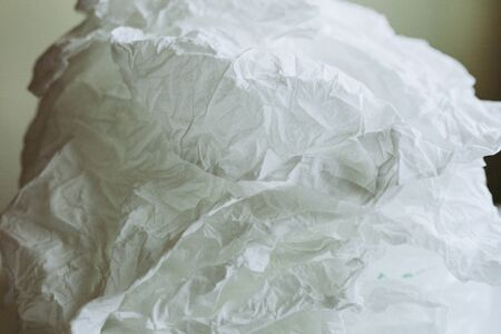 Close-up white paper tissue background.