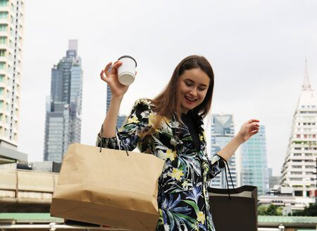 Beautiful woman business shopping and traveling in the city. Stock Photo