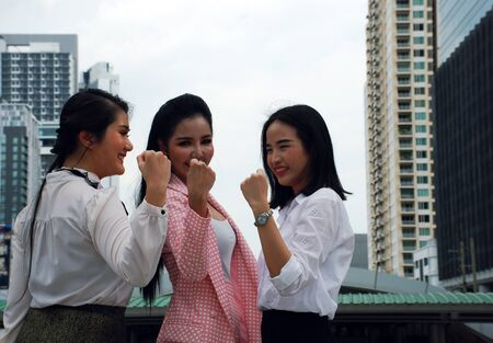 Beautiful three business woman smile portrait and very happy concept at outdoor. Banco de Imagens