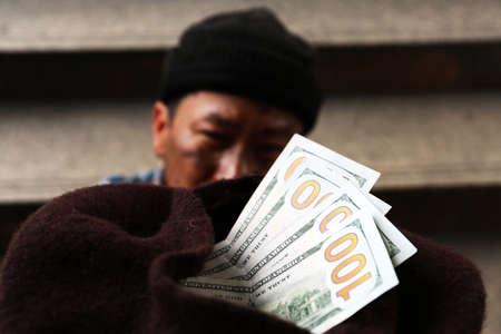 Close-up homeless senior man wish money on walking street.