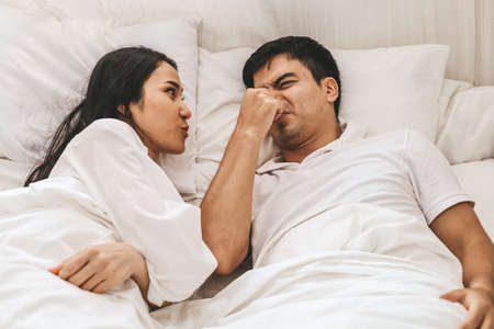 Wife can't sleep Because the husband snores loudly on bedroom in morning.