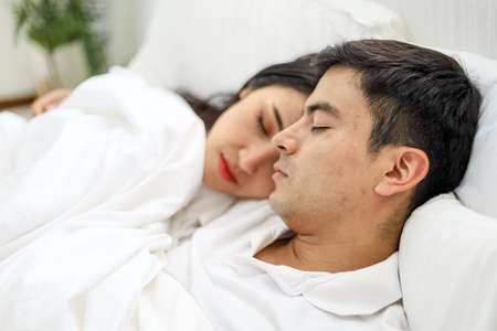 Happiness young couple lover sleeping and relaxation on bedroom.