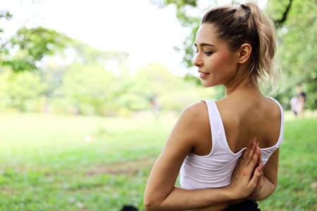 Happiness woman yoga sport exercise at garden. Imagens
