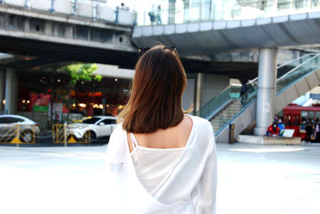 Beautiful Asian young woman smile and traveling vacation in city.