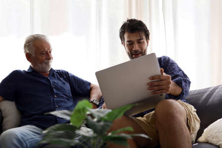 Father and son, discussing business at home, are in trouble at home.