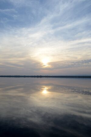 Sunset at a salt lake in Cyprus with water reflections