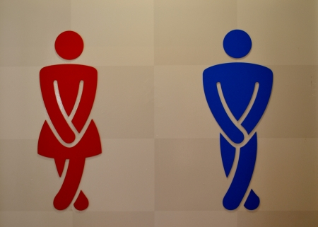 Toilet sign with a man and a woman photo