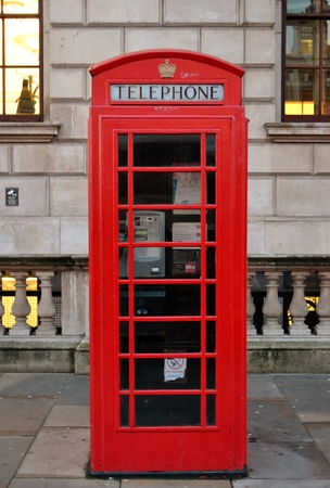 old english: Red telephone box from London  Stock Photo