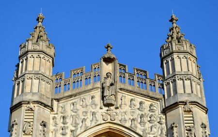 Facade from Bath cathedral and blue sky photo