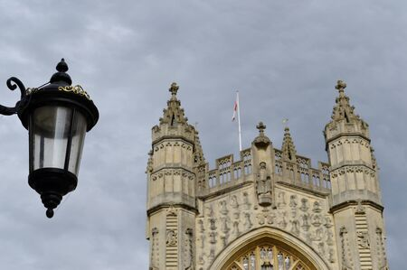 Facade from Bath cathedral and grey sky photo
