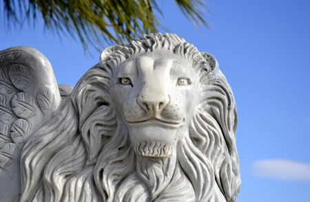 Winged lion of Venice and blue sky photo