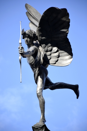 eros: Eros statue and blue sky Stock Photo