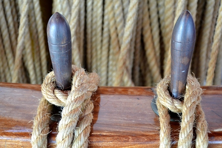 Details of tied rope from boat and wooden tools with background