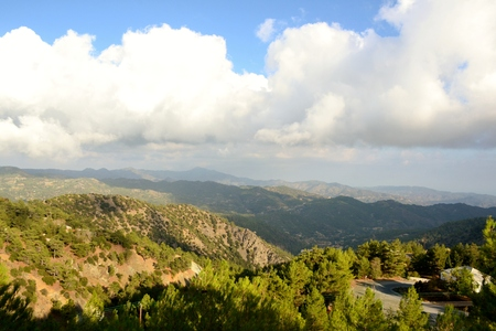 Landscape of Troodos mountains from Cyprus and cloudy blue sky
