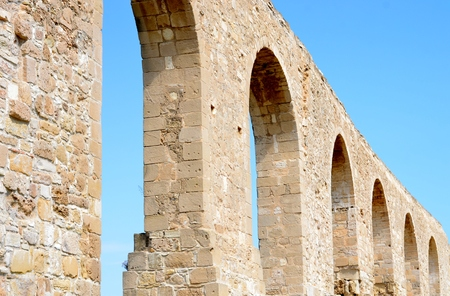 Ruins of old Kamares aqueduct from Cyprus with blue sky