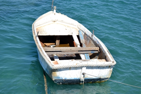 Outdoor shot of a boat with blue colors and background