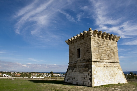 Outdoor architecture of an ancient Venetian tower in Cyprus and cloudy blue sky