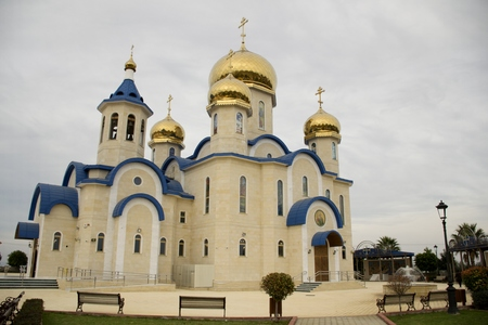 Exterior architecture of Russian Orthodox church in Cyprus and cloudy sky Фото со стока