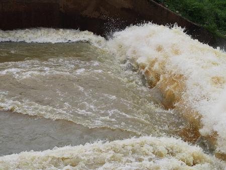 weir: Turbulent  flow of water pass a weir after the rain