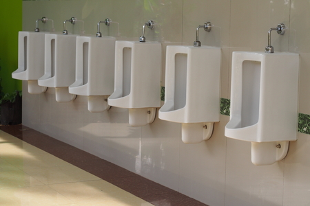 chamber pot: White urinals at public toilet. Stock Photo