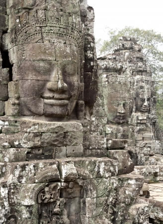 arcane: Ancient stone  head of Bayon Tample in Angkor Thom, Cambodia, South East Asia. Tradition, Culture and Religion.