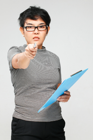 women face stare: unhappy woman pointing the pen to the camera