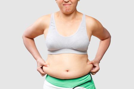 mujer celulitis: Mujeres vientre grasa corporal Foto de archivo