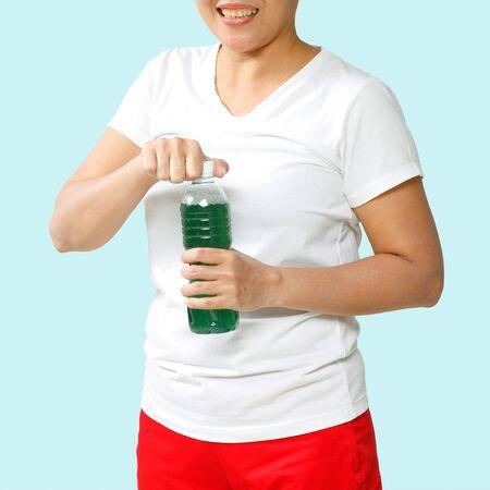 chlorophyll: woman drinking chlorophyll water