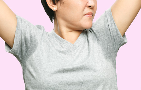 woman with sweating very badly under armpit