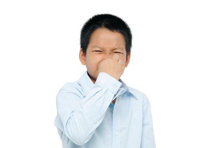 stench: boy closing nose Stock Photo