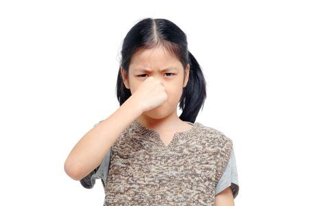 stinks: girl closing nose Stock Photo
