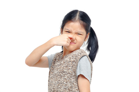 girl closing nose