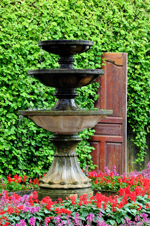 Round water fountain in the garden