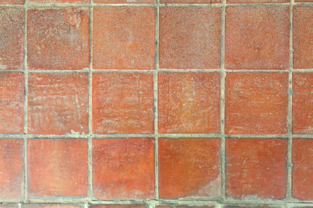 Orange earthenware floor tile seamless background and texture.
