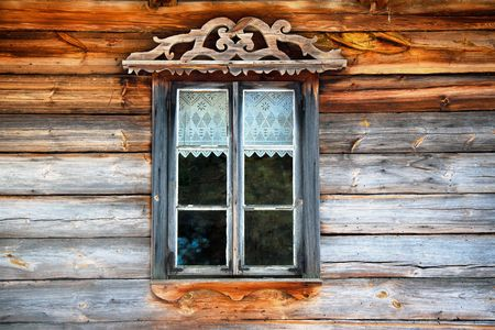 Window in wooden old wall Stock Photo