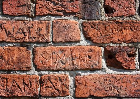 chiseled: Inscriptions chiseled in bricks wall