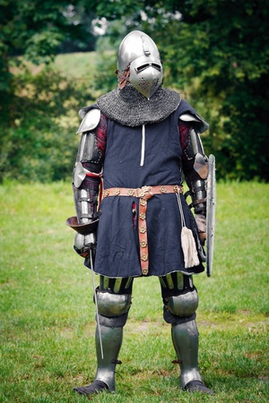 reenactor: Armored  Knight ready for the duel at the Medieval Fair in Uniejow. August 06 2011 Poland Editorial