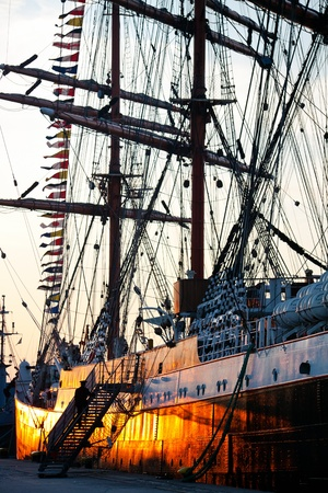 barque: Tall ship,barque Sedov on sunset, in port at Culture 2011 Tall Ships Regatta,20 large vessels,dozen of smaller boats,1000 participants.September 05,2011 in Gdynia, Poland