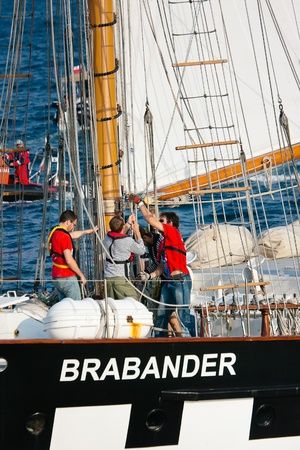 Sailing vessel Brabander setting sails during Culture 2011 Tall Ships Regatta,20 large vessels,dozen of smaller boats,1000 participants.September 05,2011 in Gdynia, Poland
