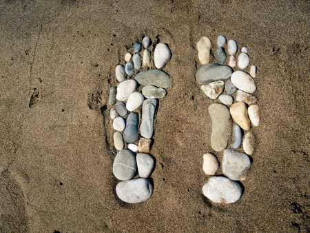 Stone feet in the sand