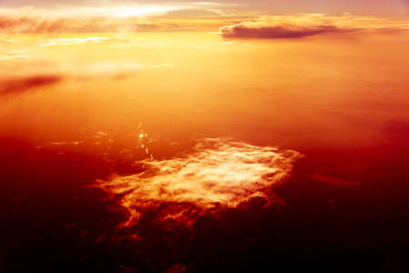 Red sky, Dreamy view over the clouds at the sunset Stock Photo