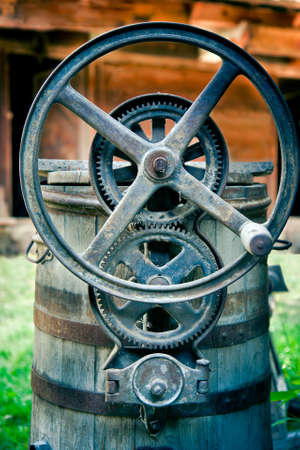 Iron gears of the vintage, wooden machinery Stock Photo