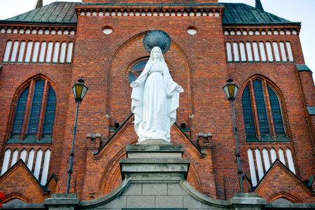 neo gothic: Church of the Immaculate Conception in Pruszkow   Masovia   Poland  XIX century  and Virgin Mary statue