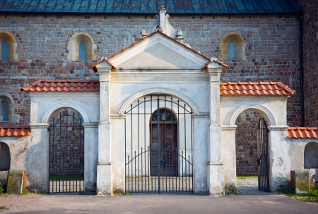 Stylish gate of the Church of St  Mary and St  Alexius in Tum  near Leczyca    Poland XII   XIV century, romanesque style  Northern side